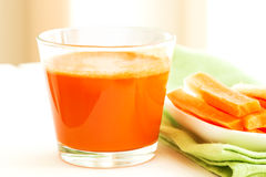 Set with juice and carrots Royalty Free Stock Photos