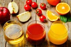 Set of juices: orange, tomato and apple Stock Image