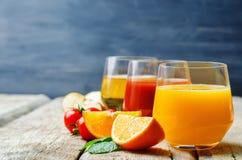 Set of juices: orange, tomato and apple Royalty Free Stock Photos