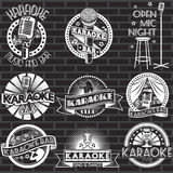 Set of karaoke club white labels and logos with black background. Vector badges and stickers Stock Photography