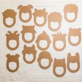 Set karton maski na białym ściana z cegieł Fotografia Stock
