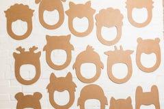 Set karton maski na białym ściana z cegieł Zdjęcie Royalty Free