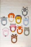 Set karton maski na białym ściana z cegieł Zdjęcie Stock