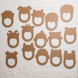 Set karton maski na białym ściana z cegieł Fotografia Royalty Free