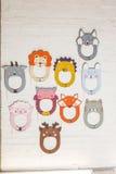 Set karton maski na białym ściana z cegieł Zdjęcia Stock
