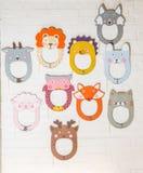 Set karton maski na białym ściana z cegieł Obrazy Stock