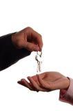 Set of keys. Man handing a women a set of keys royalty free stock image