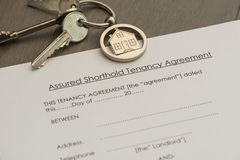 Set of Keys and tenancy agreement document. On a worktop. Rental concept, close up view Stock Image