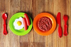 Set of kids dishes. Children`s toys. Children`s kitchen game. Royalty Free Stock Photography