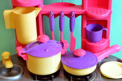 Set of kids dishes. Children's toys. Kitchen utensils Royalty Free Stock Image