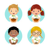 Set of kids holding young plant Royalty Free Stock Images