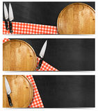 Set of Kitchen Banners with Blackboard. Collection of three kitchen banners with round cutting board, red and white checked tablecloth, kitchen knives on empty Royalty Free Stock Photography