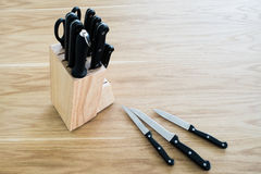 Set of kitchen knife on wooden table Stock Photo
