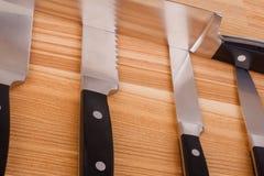 Set of kitchen knifes on wooden background Stock Photos
