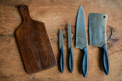 Set of kitchen knifes on wooden cutting board Royalty Free Stock Images