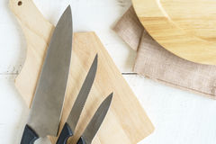 Set of kitchen knives on wooden cutting board Stock Image