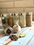 A set of kitchen spices on a beautiful wooden stand. royalty free stock image