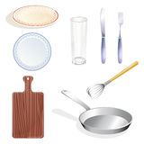 Set kitchen utensils. Small set from kitchen utensils and tableware on the white background Royalty Free Stock Photo