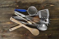 Set  of kitchen utensils. On brown background Royalty Free Stock Photos