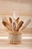 Set of kitchen utensils on wooden board Stock Photo