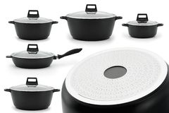 Set of kitchenware cast iron black steel isolate white background. Set of kitchenware cauldron casserole pan with glass lids black metal isolate on a white royalty free stock image