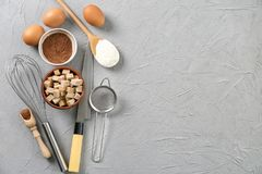Set of kitchenware and products on grey background. Cooking master classes royalty free stock image