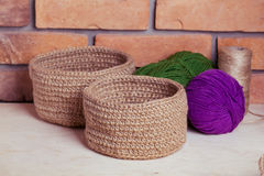 Set of knitted baskets. On brick background Royalty Free Stock Images
