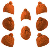 Set of knitted hats with pompon orange Stock Images