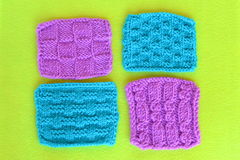 A set of knitted patterns on green felt Stock Photos