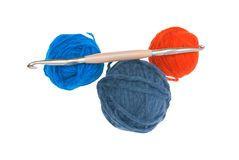Set for knitting. Threads and a hook for manual knitting on a white background Royalty Free Stock Images