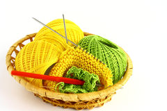 Set for knitting. In a wicker basket Stock Images