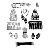 A set of knitting hats and LIC, scarf and mittens.  Royalty Free Stock Photo