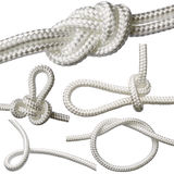 Set of knots on a white rope, isolated on a white background. Stock Photography