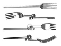 Set of knotted bent forks Royalty Free Stock Photos