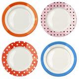 Set kolorów talerze z polki kropki wzorem odizolowywającym Fotografia Stock