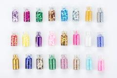 Set kolorowy gwoździa makeup połyskuje w butelce Obraz Royalty Free