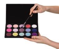 Set kosmetyki dla makeup i muśnięcie w kobiet rękach odizolowywać na bielu Obrazy Royalty Free