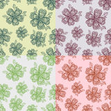 Set of l floral seamless patterns with hand drawn doodle flower illustrations Stock Photos