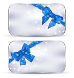 Set labels with blue gift bows isolated Stock Photos