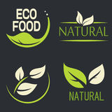 Set of labels, logos with text. Natural, eco food. Organic food. Badges in vector cosmetic, food. Vector logos. Natural logos with leaves royalty free illustration