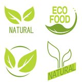 Set of labels, logos with text. Natural, eco food. Organic food. Badges in vector cosmetic, food. Vector logos. Natural logos with leaves Royalty Free Stock Images