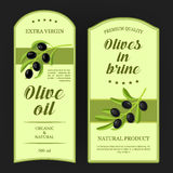 Set of labels for olive oil with black olives branches. Vector stickers used for advertising olives in brine. Royalty Free Stock Images