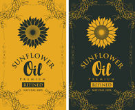 Set labels for refined sunflower oil with curlicue. Set of two vector labels for refined sunflower oil with sunflower and the inscription on black and yellow Stock Photos