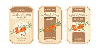 Set of labels for seabuckthorn seed oil. Set of threelabels for seabuckthorn seed oil Royalty Free Stock Photography
