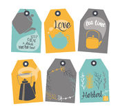 Set of labels with a tea design. Teapots decorated with hand-drawing, speech bubbles, and signs. Background white, colored tags Stock Photography