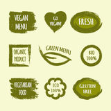 Set of labels with text Go Vegan, Fresh, Green Menu, Organic Pro. Set of green grunge labels with text Go Vegan, Fresh, Green Menu, Organic Product, BIO 100% Stock Photos