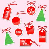 Set of labels to Prenew Year's sale. On a pink background Royalty Free Stock Image