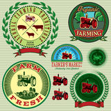 Set of labels with a tractor for livestock and crop. Set of vector labels with a tractor for livestock and crop stock illustration
