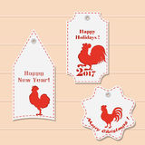 A set of labels of various shapes with the New Year and Christmas design. Cut paper. Symbol Rooster year. vector illustration