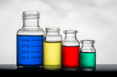 Set of laboratory bottles with liquid Royalty Free Stock Photo